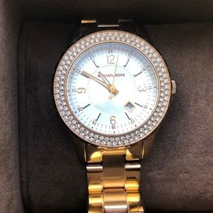 Micheal Kors rose gold toned watch